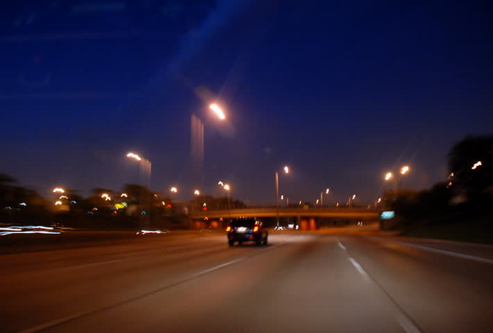 Driving on highway into city tunnel at night time lapse