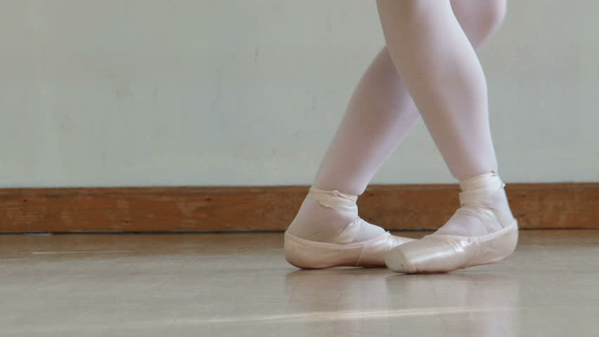 Close up of a ballet dancer's feet as she practices point exercises. - HD stock video clip