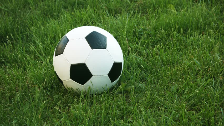 The Rolling Soccer Ball On The Field. Loop-able And ... Rolling Soccer Ball