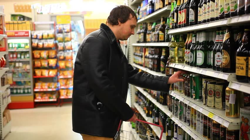 RUSSIA, 14 FEBRUARY 2015, man choosing products in alcoholic during weekly shopping at supermarket store. HD. 1920x1080