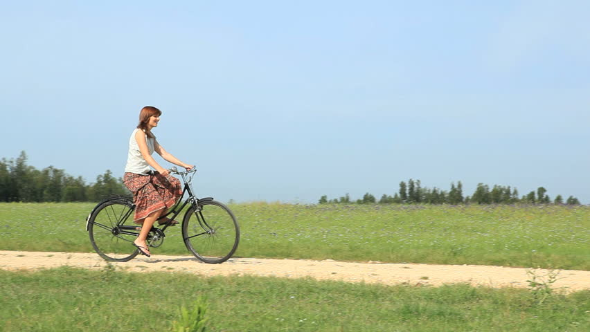 HD video clip of a young girl girl riding a bicycle