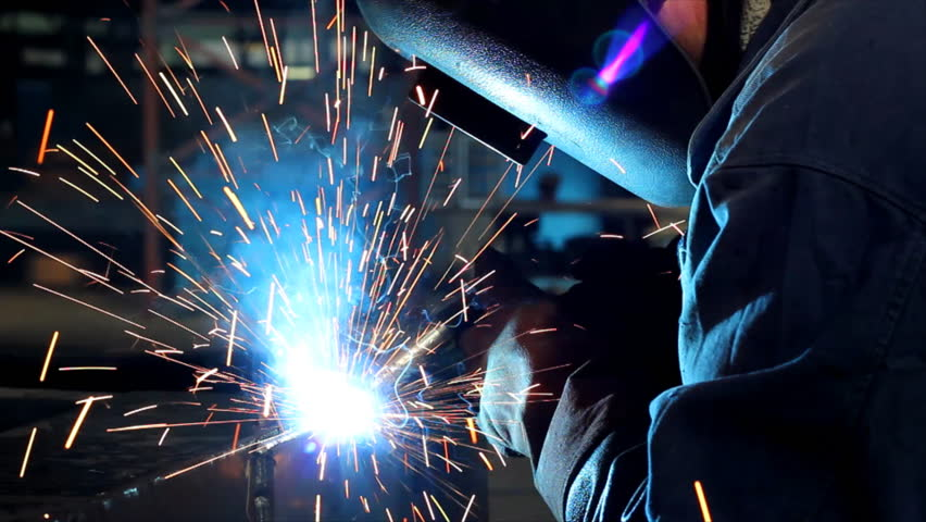 Welder at work in factory - HD stock video clip