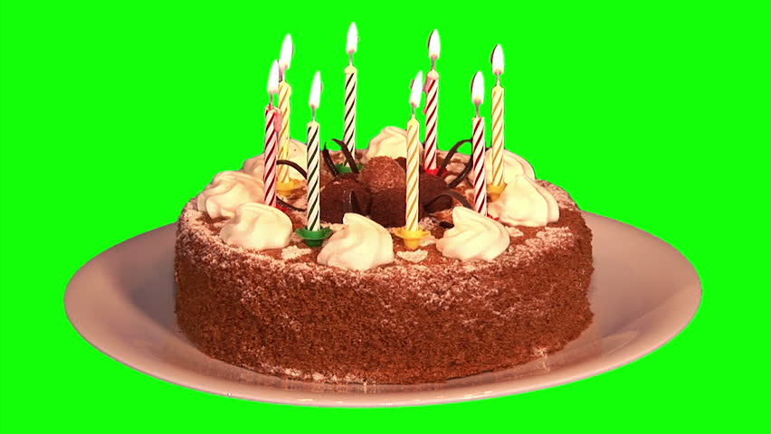 honey cake on plate with eight lighting and blowing candles on green ...