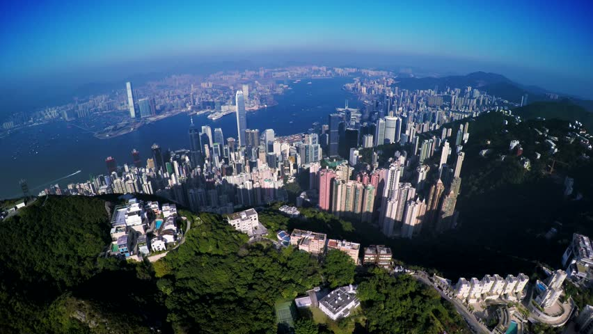 4K Aerial Shot of Hong Kong of China. Flying backward from the Peak of Hong Kong Island to Kowloon Peninsula. Overlooking the commercial and residential buildings. | Shutterstock HD Video #9059917
