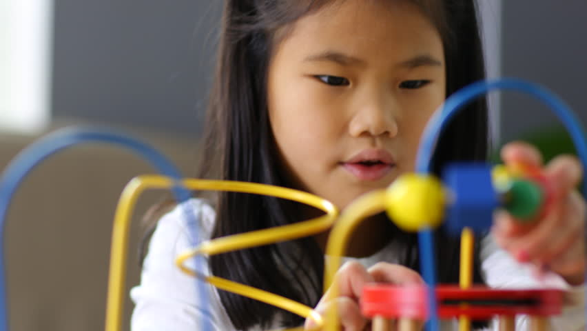 Young Asian girl playing with toys