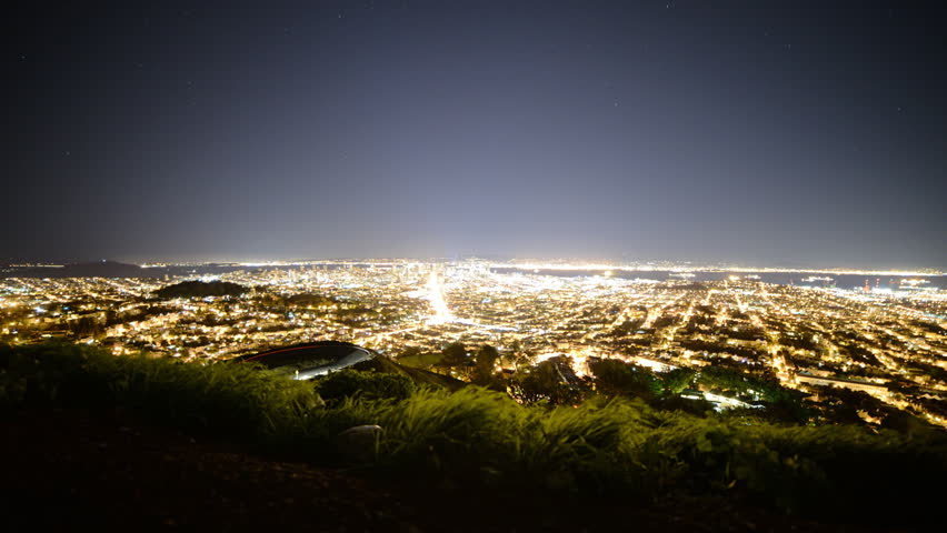 Motion controlled time lapse with dolly up left motion of night cityscape of San Francisco Bay Area in California