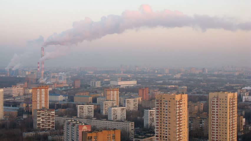One of the districts of Moscow, smoke comes from the pipes of factories. Time lapse.   - HD stock footage clip