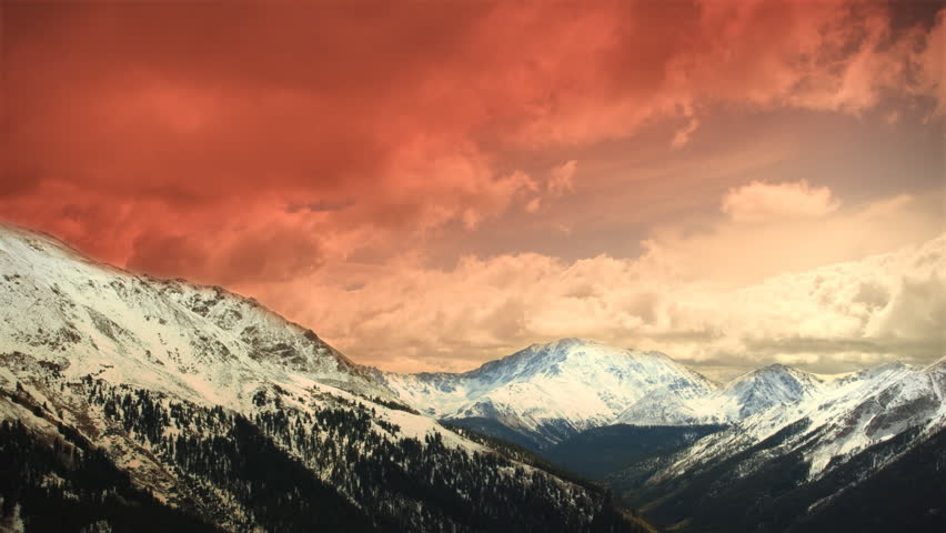 Early Early Winter Mountains Snow Sunset Clouds Skiing. Great for themes of skiing, winter sports, adventure, mountains, nature, weather, tourism, travel. Excellent loop for nature composites.