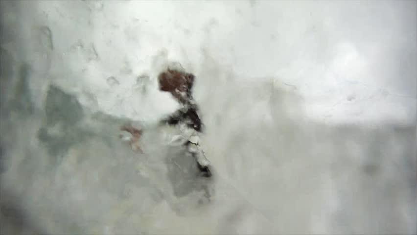 Surfer gets a barrel on a big wave.