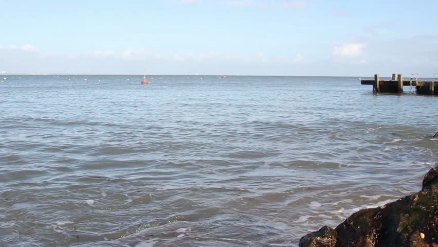 small waves lapping on the shore - HD stock footage clip