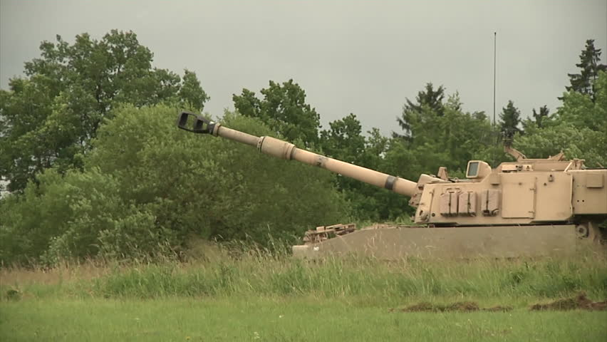 CIRCA 2010s - U.S. M109A6 Paladin tanks are fired at a range in Germany.
