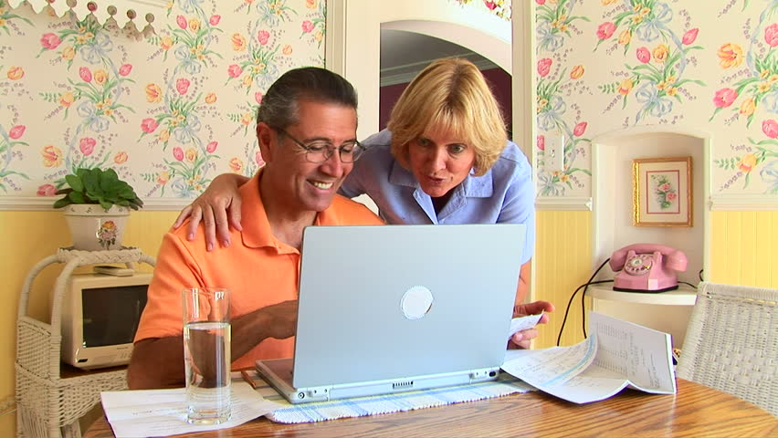 Mature couple using laptop - HD stock footage clip