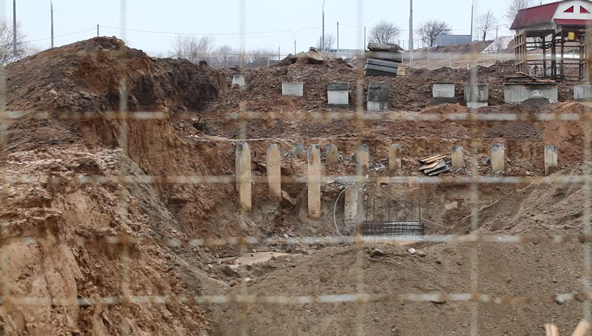 pit with concrete piles for the construction of prefabricated house