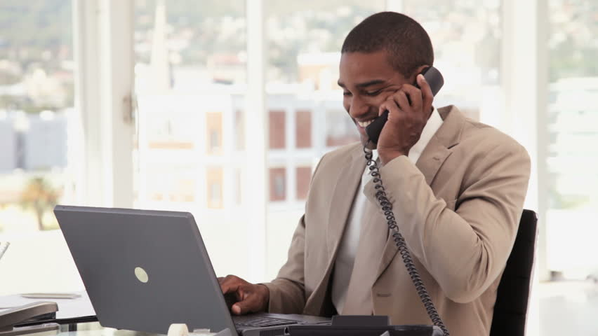 Businessman Using a Phone at the Office - HD stock footage clip