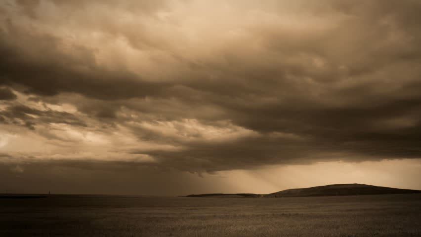 Eerie, moody cloudscape time lapse, with a few lightning bolts, processed in Sepia tone. HD 1080p. - HD stock video clip