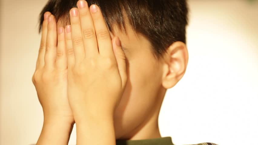 boy playing peekaboo  - HD stock footage clip