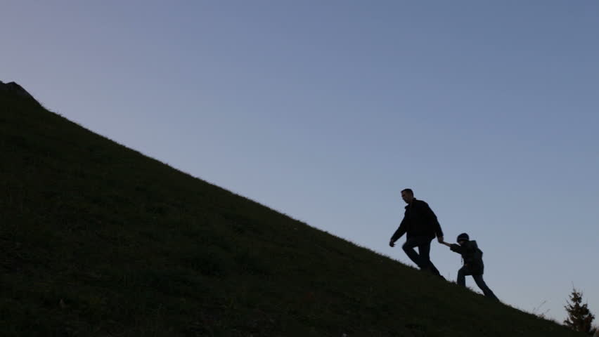 father and son climbing uphill, metaphor - HD stock footage clip