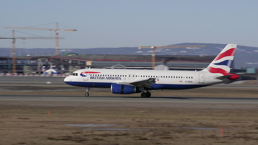 JET PASSENGER AIRPLANE LANDING ON RUNWAY - CA MARCH 2015: British Airways Airbus A319 landing at Oslo Airport Norway