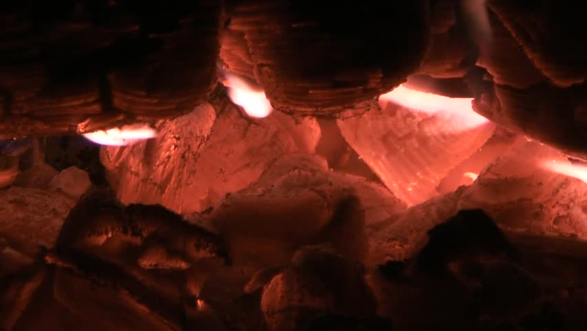 Embers of coal background - close- up. Campfire closeup. Natural background - HD stock footage clip