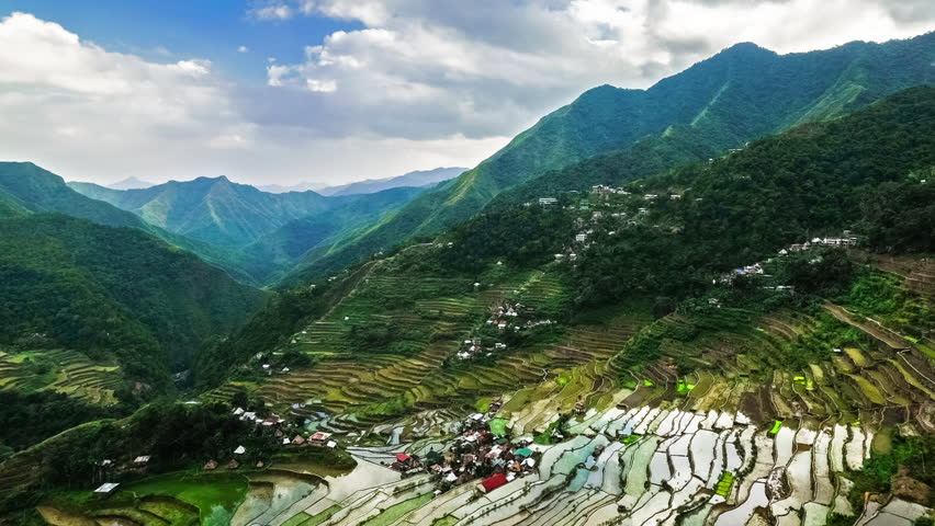 Zooming time lapse of cloudy blue sky over rice terraces fields in Ifugao province mountains. Philippines UNESCO heritage