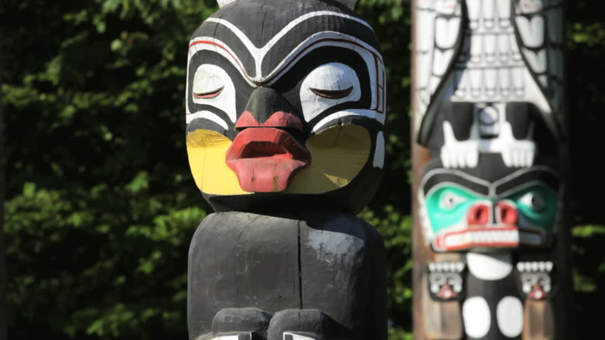 Vancouver, BC, Canada, downtown Stanley Park's collection of Native totem poles, dolly shot/ tracking shot, rack focus - HD stock video clip