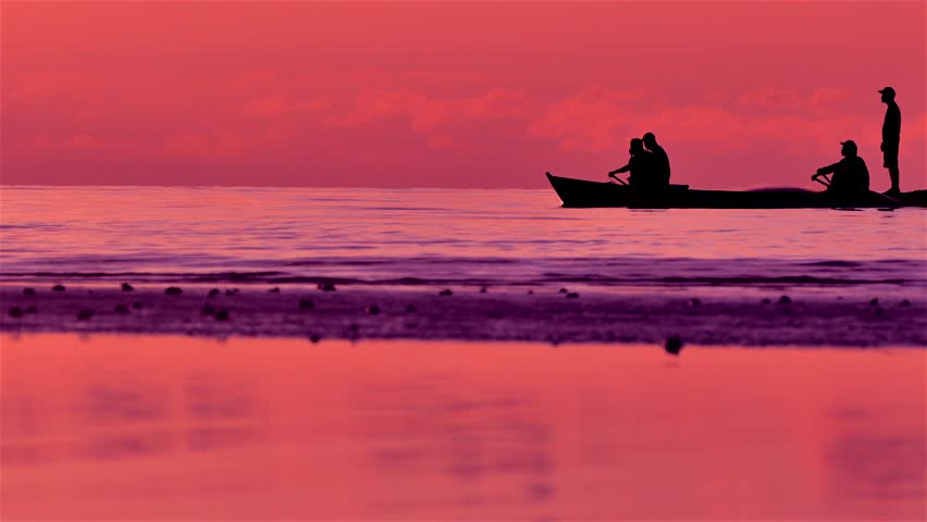 Silhouettes of Philippines Fishermen on Horizon in Boats in Sunset Light, Bohol, Philippines