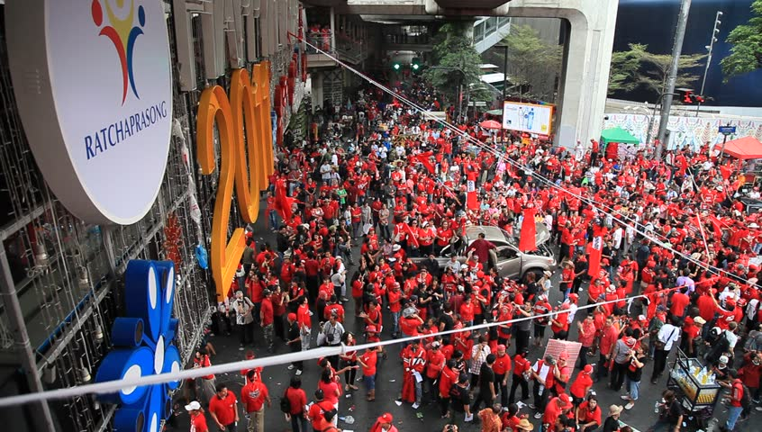 BANGKOK, THAILAND - NOVEMBER 19: At least 10,000 anti-government red-shirted protesters returned to Bangkok's streets to mark the 6 month anniversary of a deadly military crackdown on 19th November 2010. - HD stock video clip
