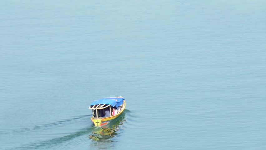 MAGAT RIVER, ALFONSO LISTA, IFUGAO - APRIL 3, 2015: boat sailing leaving from Magat lake pier during summer