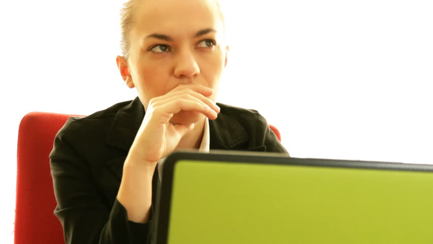 Attractive businesswoman finding solution in front of the laptop  - HD stock footage clip