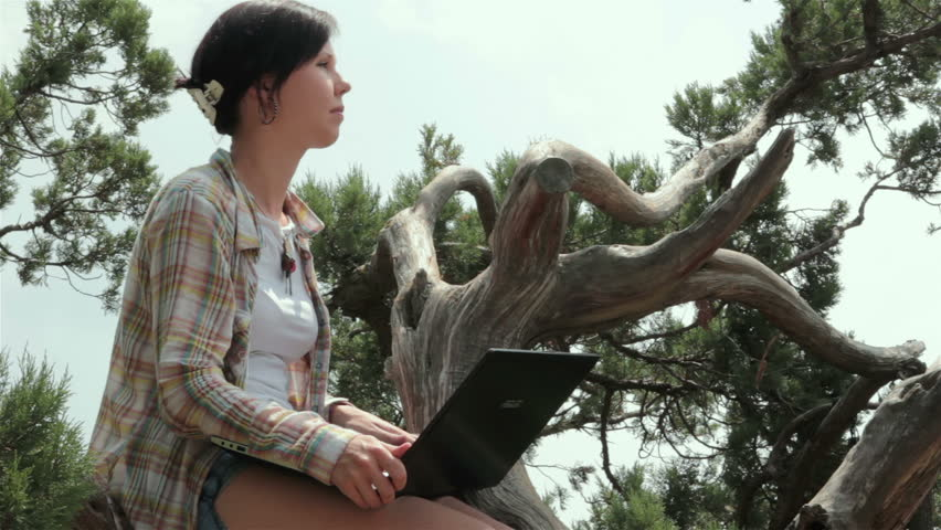 Girl with laptop in nature closeup