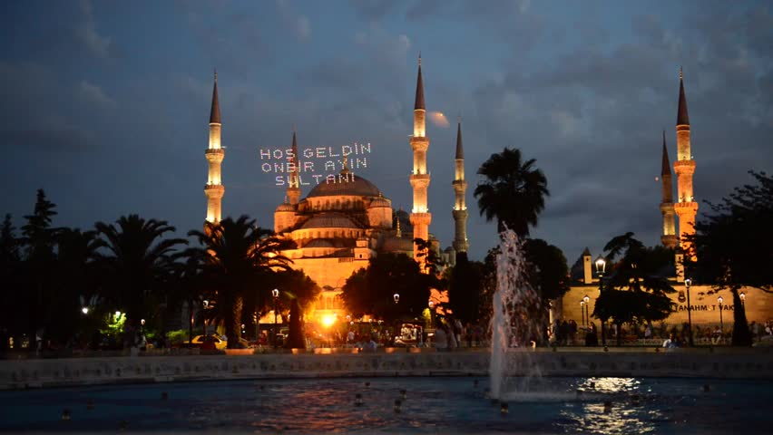 ISTANBUL, TURKEY - JUNE 27: Mosque lights illuminate all the streets during holy month of Ramadan on June 27, 2014 in Istanbul. Ramadan is given in each text message with minaret in Turkey. - HD stock footage clip