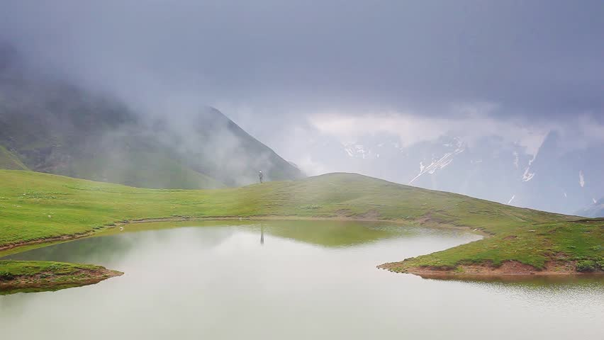 The majestic green hills in foggy weather. Koruldi Lakes, Upper Svaneti, Georgia, Europe. The main Caucasus ridge. Dramatic unusual scene. Beauty world. HD video (High Definition)