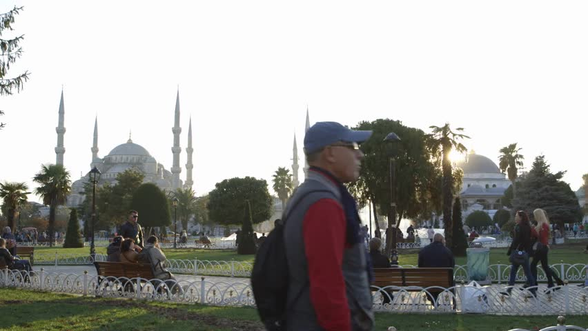 Istanbul, Turkey, October, 2014. A Time-lapse of the sun coming down from day to night-Sunset with a fountain in the middle, showing a famous mosque in Istanbul, Turkey. - HD stock video clip