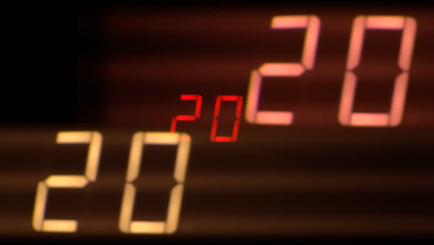 A digital countdown. Red digits on black background, with shaky duplicate reflections. Real footage. Good for: bombs, clocks, alerts, alarms, watches, stopwatches, deadlines.