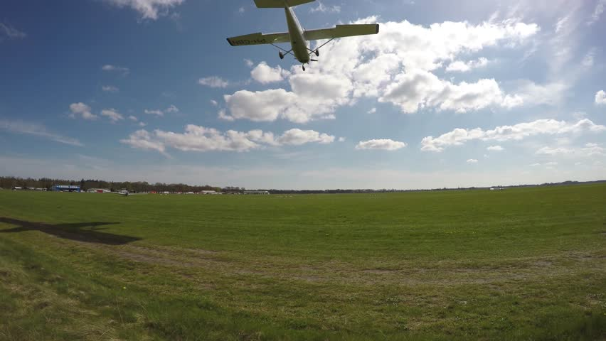 Plane landing on grass airfield 4k