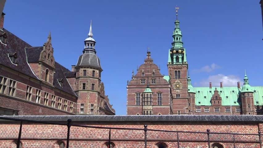 Frederiksborg Castle in Hilleroed in North Sealand near Copenhagen in Denmark. The castle is built in Dutch Renaissance style and is located on three islands in the castle lake.  - HD stock footage clip