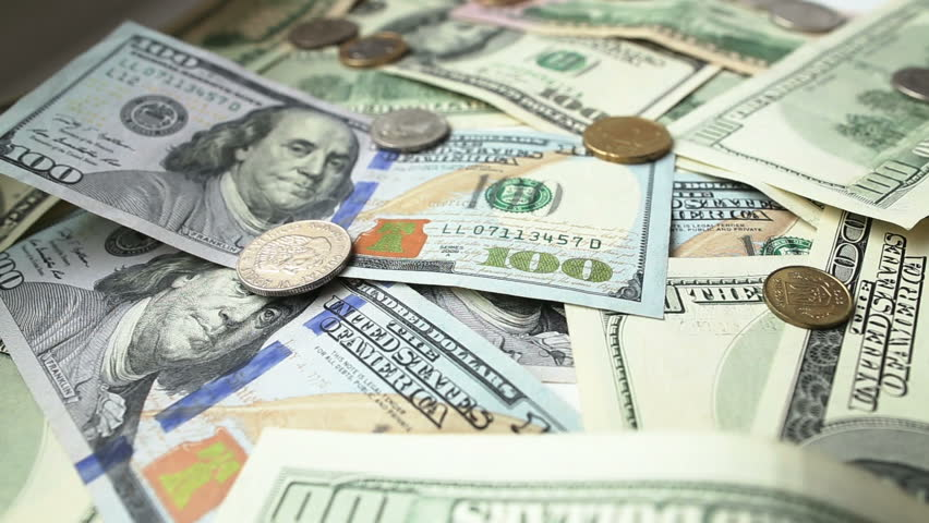 Dollar bills and coins - HD stock video clip