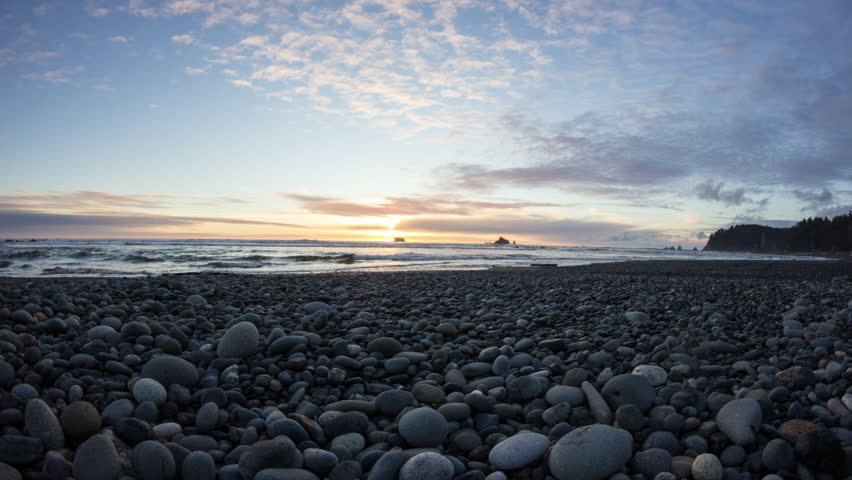 Time lapse dolly move of sunset at Rialto Beach, Olympic National Park, Washington State, USA