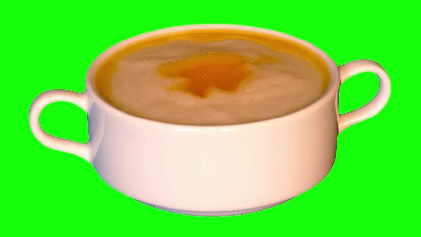Cream of wheat (cooked semolina) with butter in bowl rotating on green screen, loop, front shot