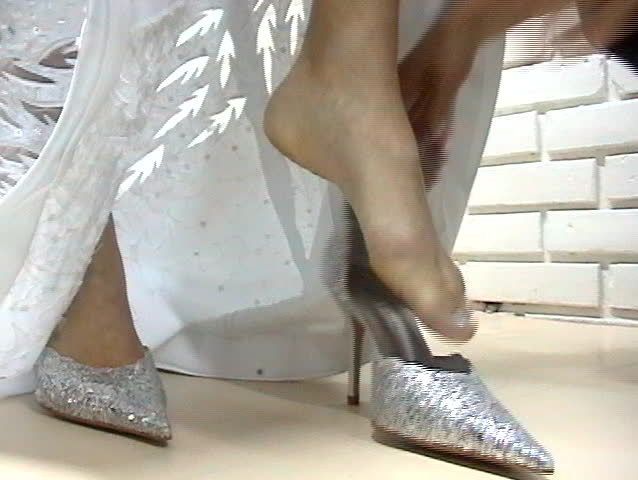 Bride putting her shoes on. - SD stock video clip
