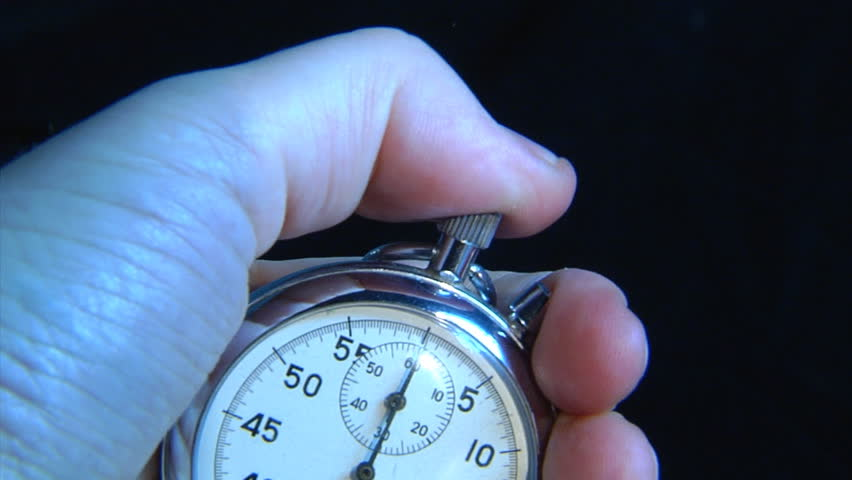 hand push the start button on stop-watch - HD stock footage clip