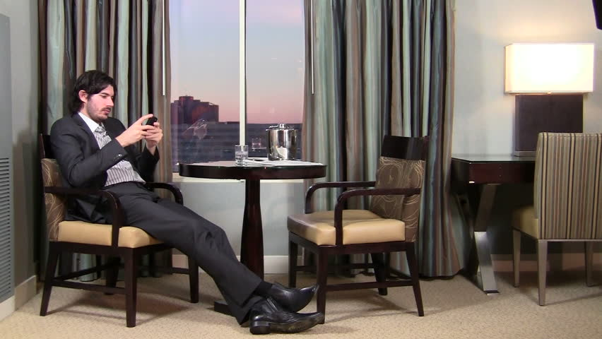 Successful businessman texts in luxury hotel room - HD - HD stock video clip